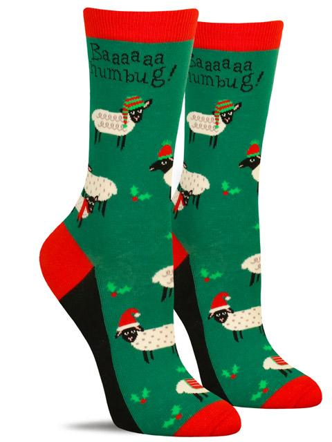 "Cute women's Christmas socks with a pattern or sheep and the words ""baaaa humbug"""