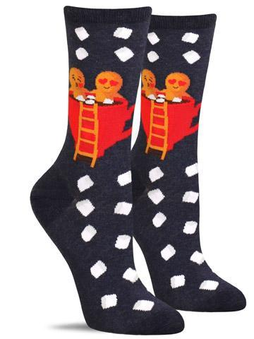Cute Christmas socks with a gingerbread couple sitting in a cup of hot cocoa with marshmallows