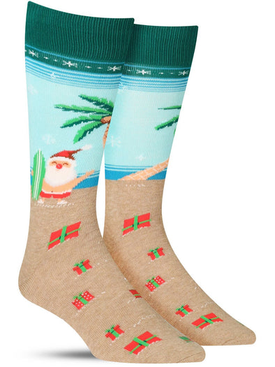 Funny men's Christmas socks with Santa on a beach with a surfboard