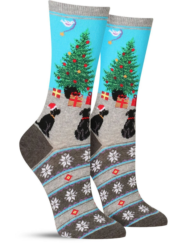 Cool women's dog socks for the holidays with two pups looking at a Christmas tree