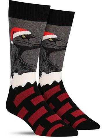 Funny Christmas dinosaur socks for men with a raptor on a snowy rooftop
