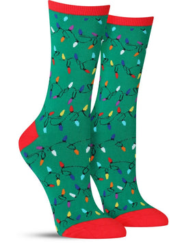 Green and red women's socks with strands of festive Christmas lights