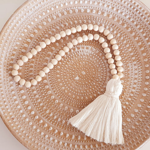 Natural beaded garland with tassel
