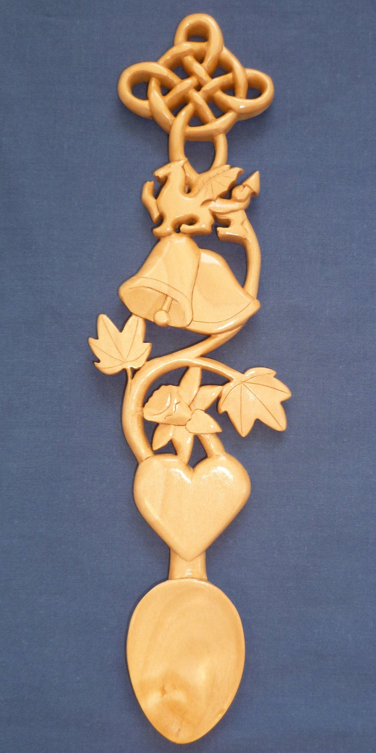 Wedding bells, dragon,daffodil and knot love spoon