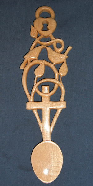 Lovebirds with cross love spoon