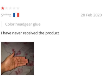 """One star review that says """"I have never received the product"""" with a picture of an empty hand."""