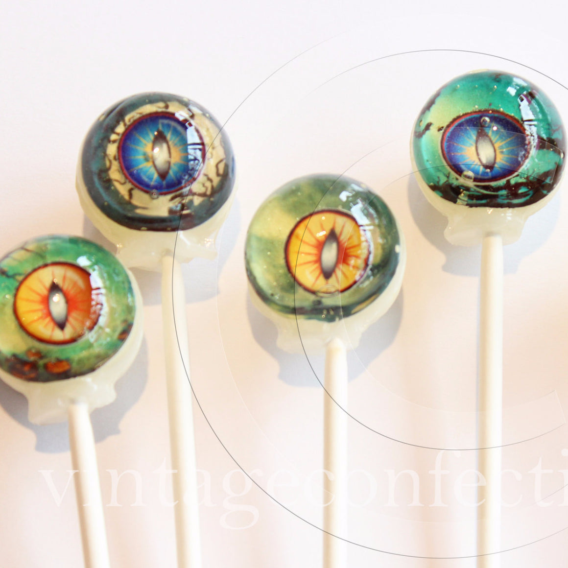 3D cat eyes Halloween lollipops by I Want Candy!