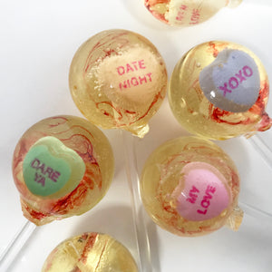 Conversation hearts lollipops by I Want Candy!