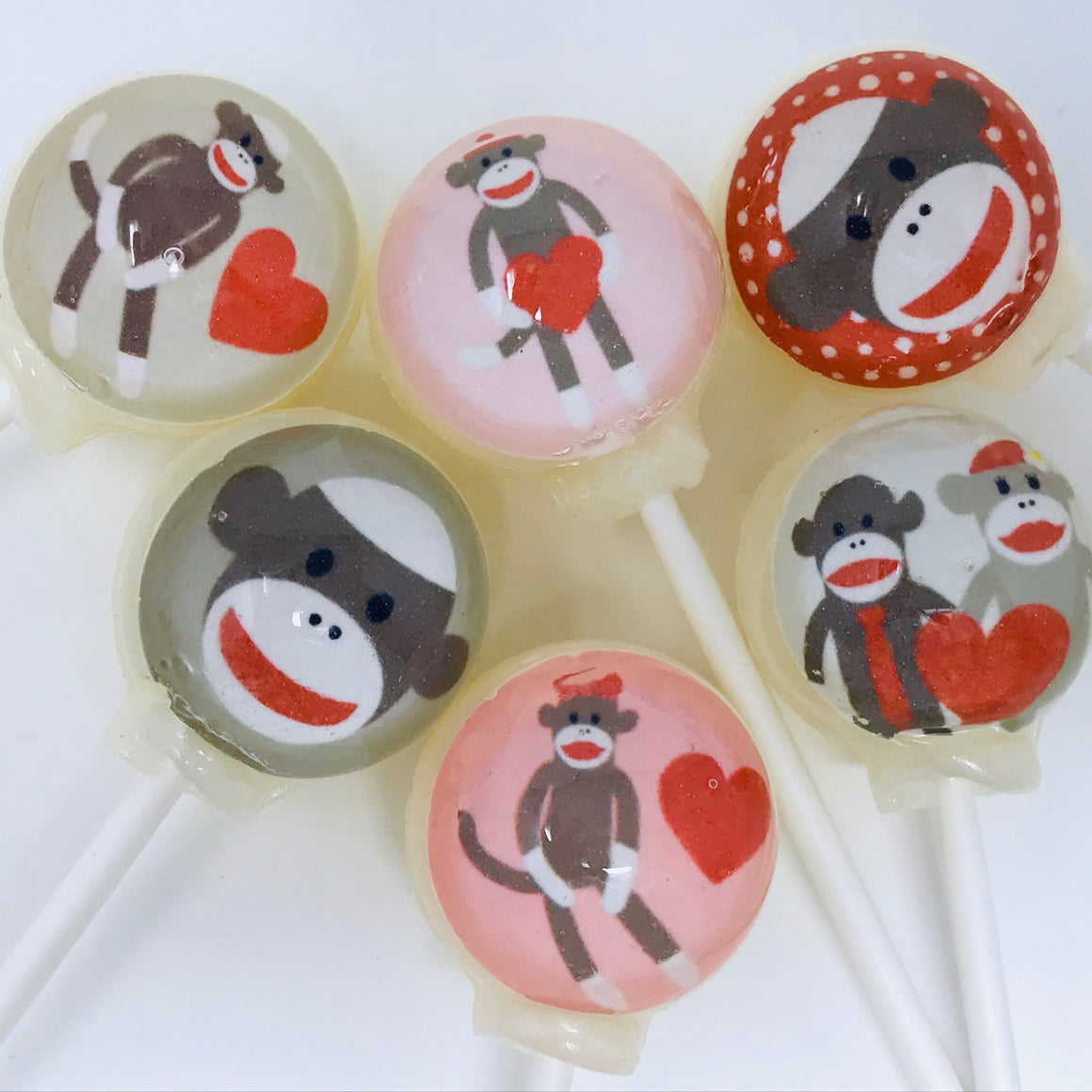 Sock monkey lollipops by I Want Candy!