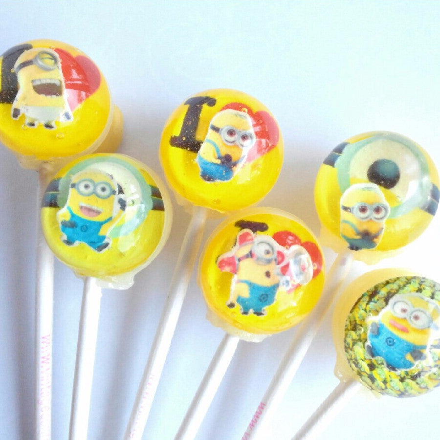 3D minion yellow guy lollipops by I Want Candy!