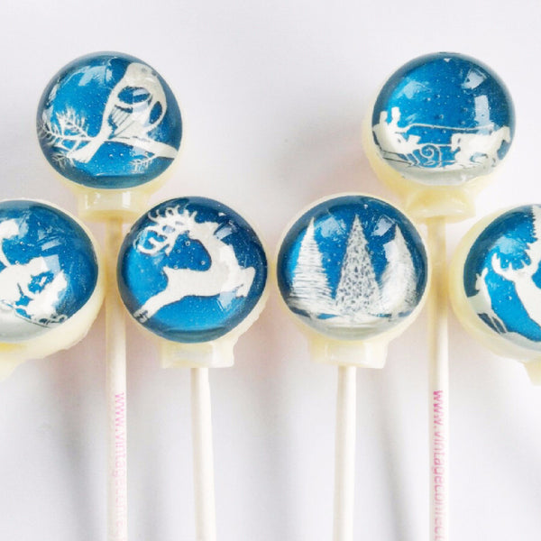 Winter paper cut outs lollipops by Vintage Confections