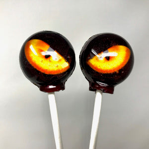 Black Cat-eye / gold stars-edible image lollipops by I Want Candy!