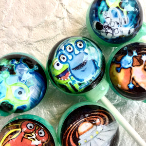 Cosmic Aliens! edible image lollipop by I Want Candy!