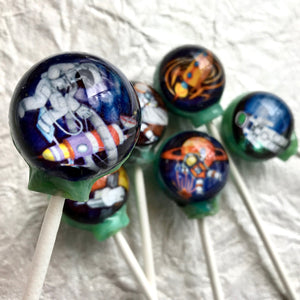 Cosmic Astronauts! edible image lollipop by I Want Candy!