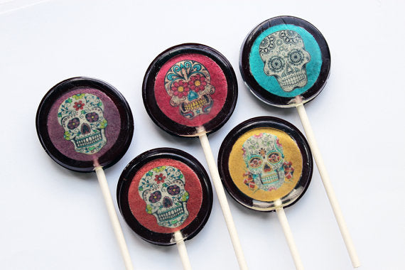 Sugar skulls lollipops by I Want Candy!