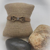 DOG BONE WITH PAW PRINT LEATHER BRACELET