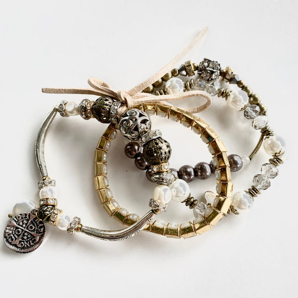 SET OF FOUR GOLD & CRYSTAL BRACELETS
