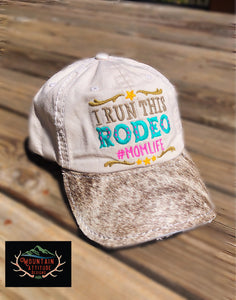 COWHIDE COLLECTION - I RUN THIS RODEO MOM LIFE BALL CAP