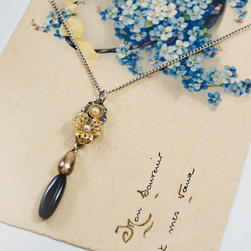 Flower and Onyx Drop Pendant Necklace by Eric et Lydie