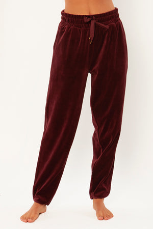 Your Luxury Lounge Wear has Landed. The Haven Velour Pant is an elastic waist pull on jogger pant with side piping detail.
