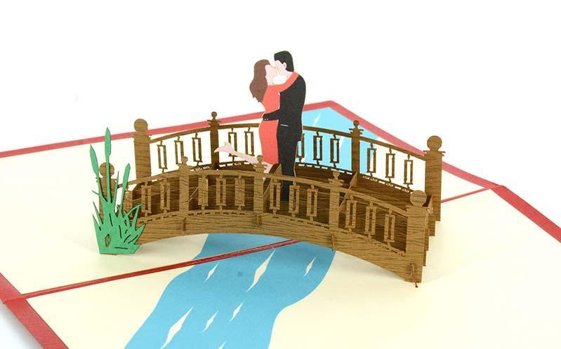 Couple kissing on bridge