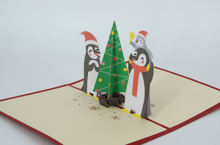 Penguins Decorating Xmas tree