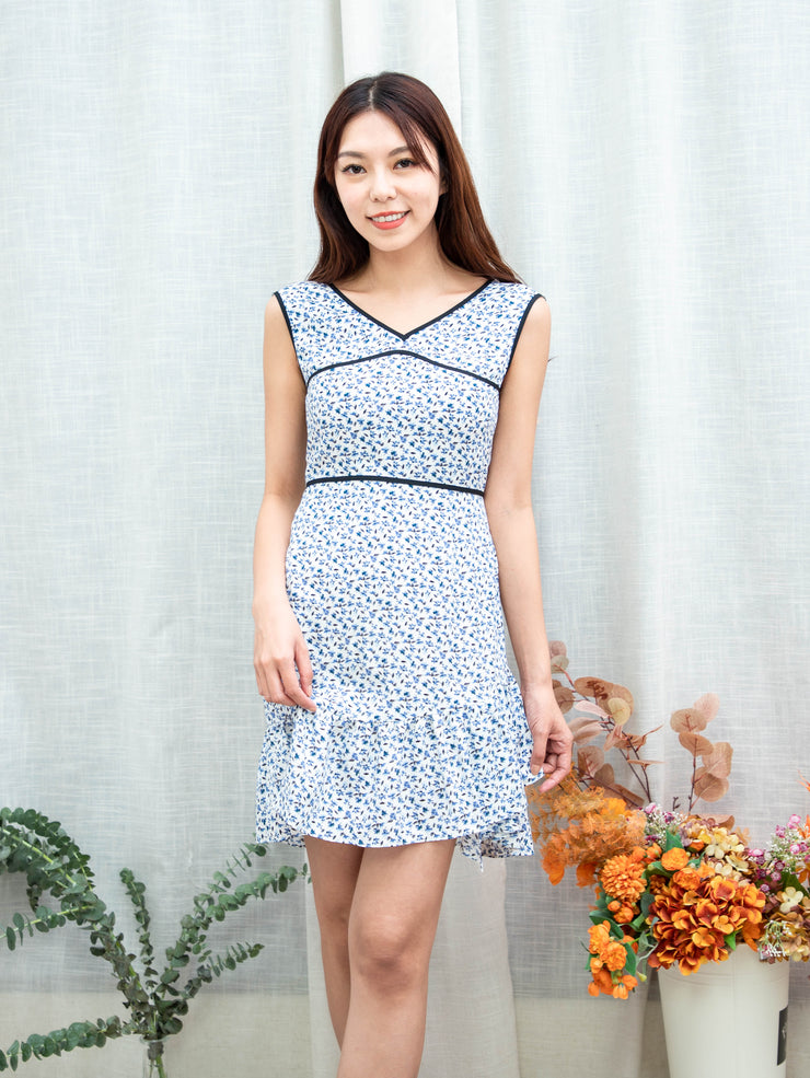 Gaily piped dress