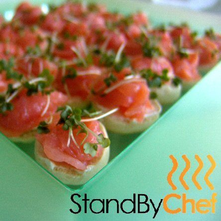 Roses of smoked salmon on half bagels for canapes party for Canape delivery