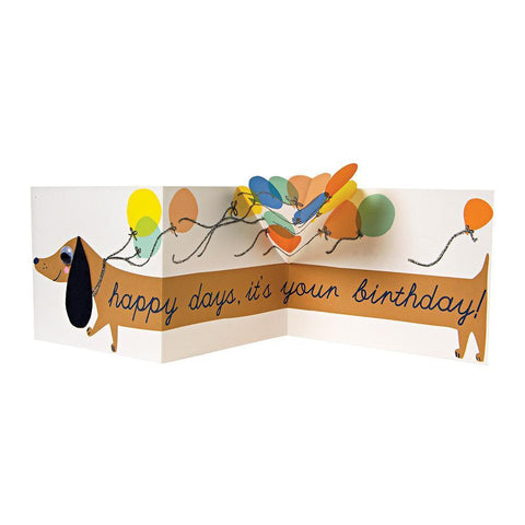 Meri Meri Birthday Greeting Card - Sausage Dog brown wiener dog with multicolored balloons