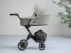 lifestyle_1, stokke xplory v6 secure flat protective carry cot hard shell height adjustable breathable exceptional ventilation extended canopy