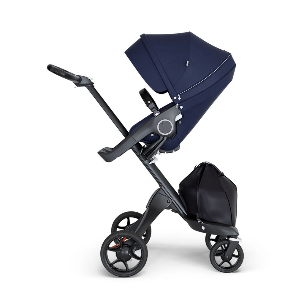 stokke xplory v6 ergonomic travel system stroller luxurious height adjustable front rear facing foldable chassis comfortable black frame black leatherette handle deep navy blue