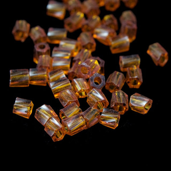 10/0 Transparent Amber Twist Hex Seed Bead