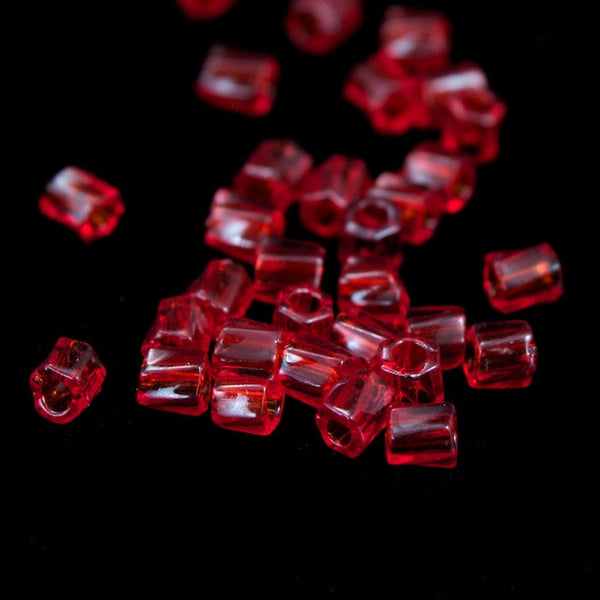 10/0 Transparent Cranberry Twist Hex Seed Bead