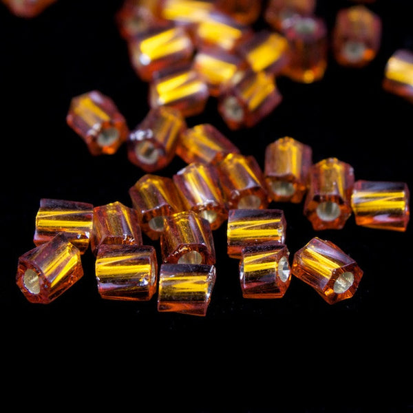 10/0 Silver Lined Topaz Twist Hex Seed Bead