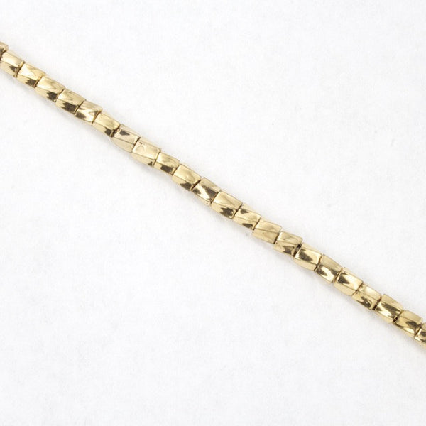 10/0 Pale Gold 22 KT Twist Hex Seed Bead