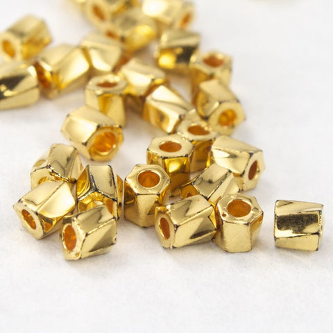 10/0 Bright Gold 22 KT Twist Hex Seed Bead