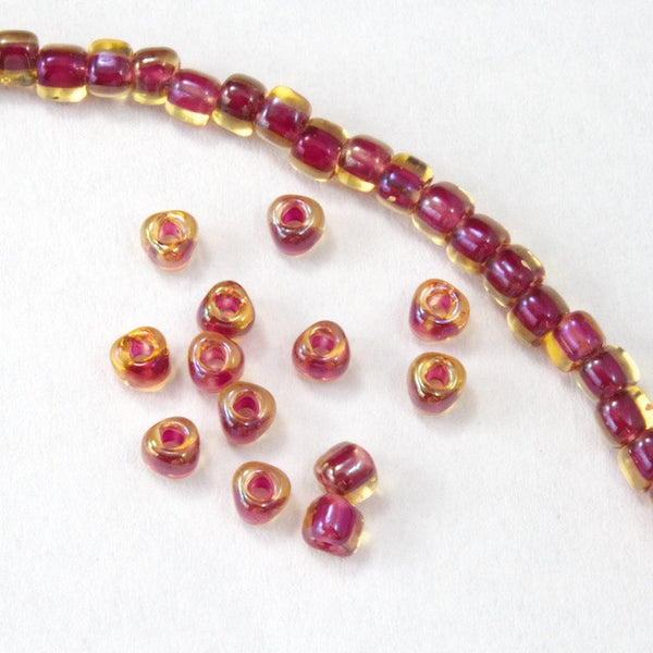 10/0 Cranberry Lined Champagne AB Miyuki Triangle Seed Bead