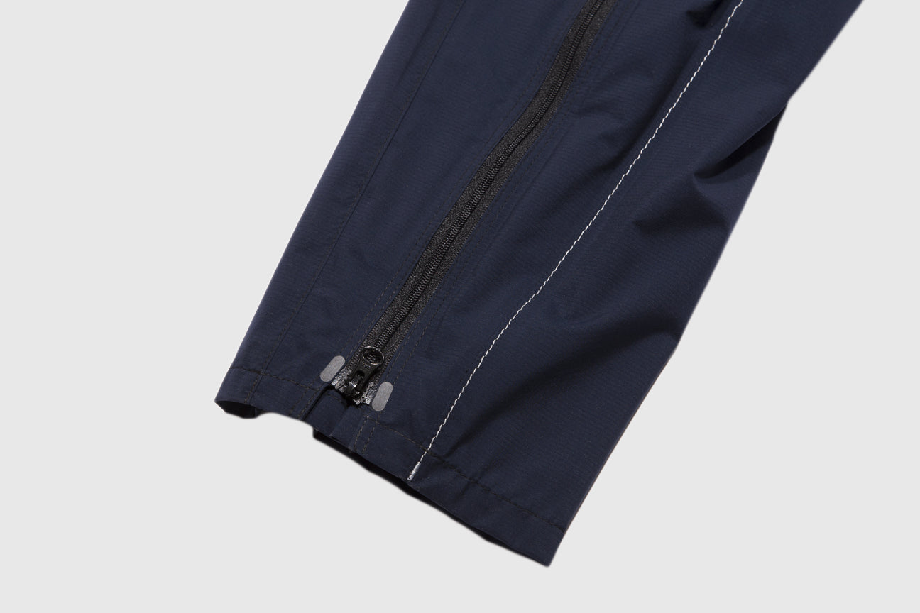 AND WANDER 3L LIGHT RAIN PANTS