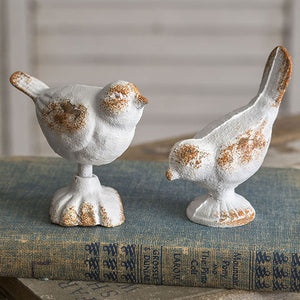 Two White Vintage Cast Iron Birds