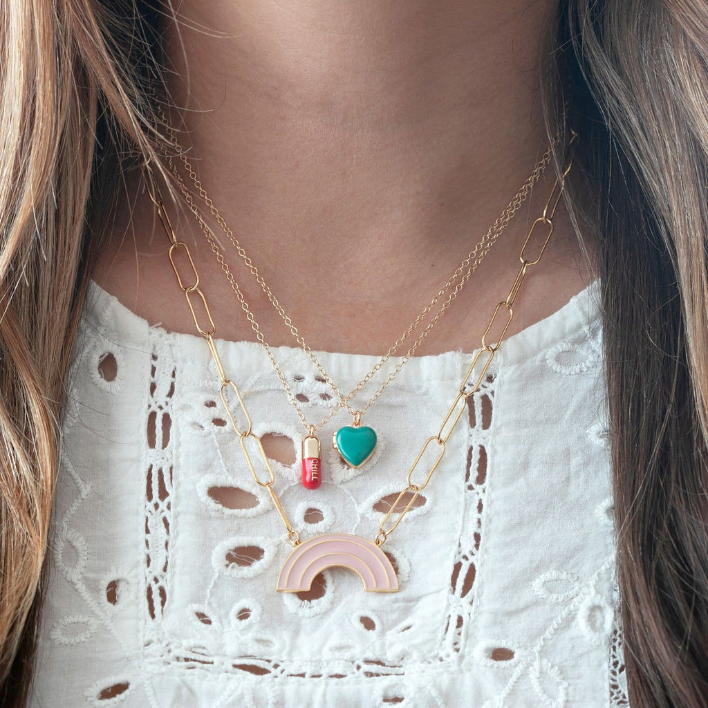 Heart Locket in gold vermeil and turquoise enamel layered with other necklaces on model.