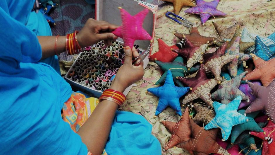 Hand stitched scarves made by Indian artisan women.