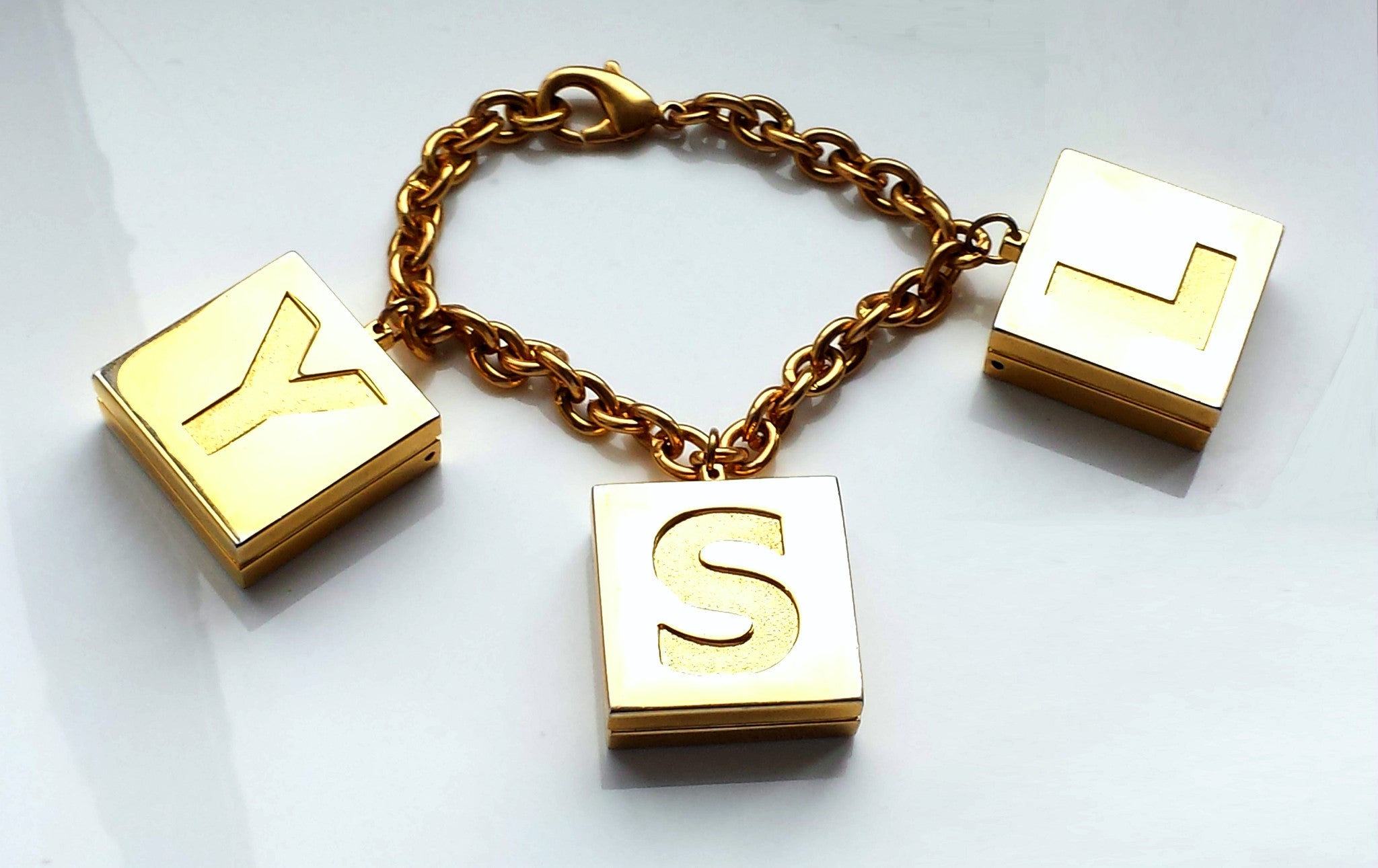 Vintage YSL Yves Saint Laurent Gold Tone Limited Edition Bracelet with Lip Gloss