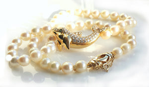 Cartier Akoya Pearl Dolphin Necklace in 18K Gold set with Diamonds & Emerald