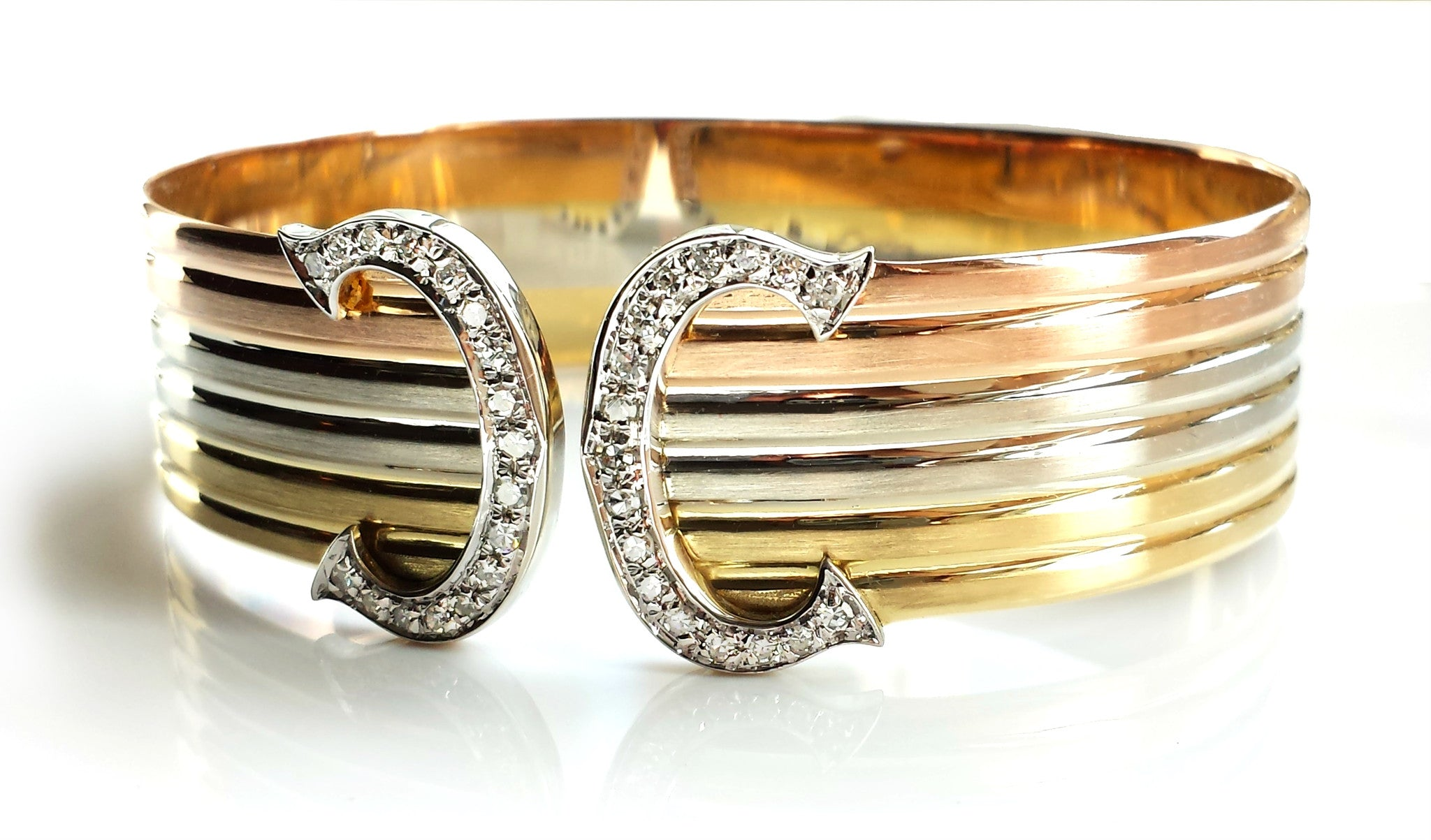 Cartier Double C 'de Cartier' Decor Trinity Bracelet in 18K gold & diamond setting