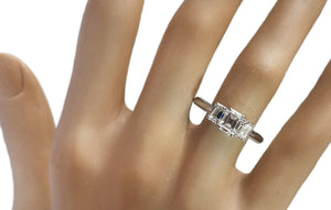 Tiffany & Co. 1.70tcw Emerald Cut 3-Stone Diamond Engagement Ring on finger