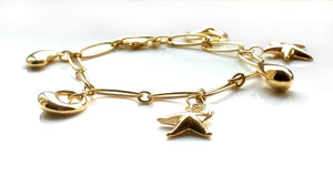 Tiffany & Co. Charm Bracelet by Elsa Peretti in 18k Gold – with Extra Charm