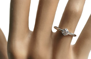 Tiffany® Setting Brilliant Cut Diamond Engagement Ring on hand