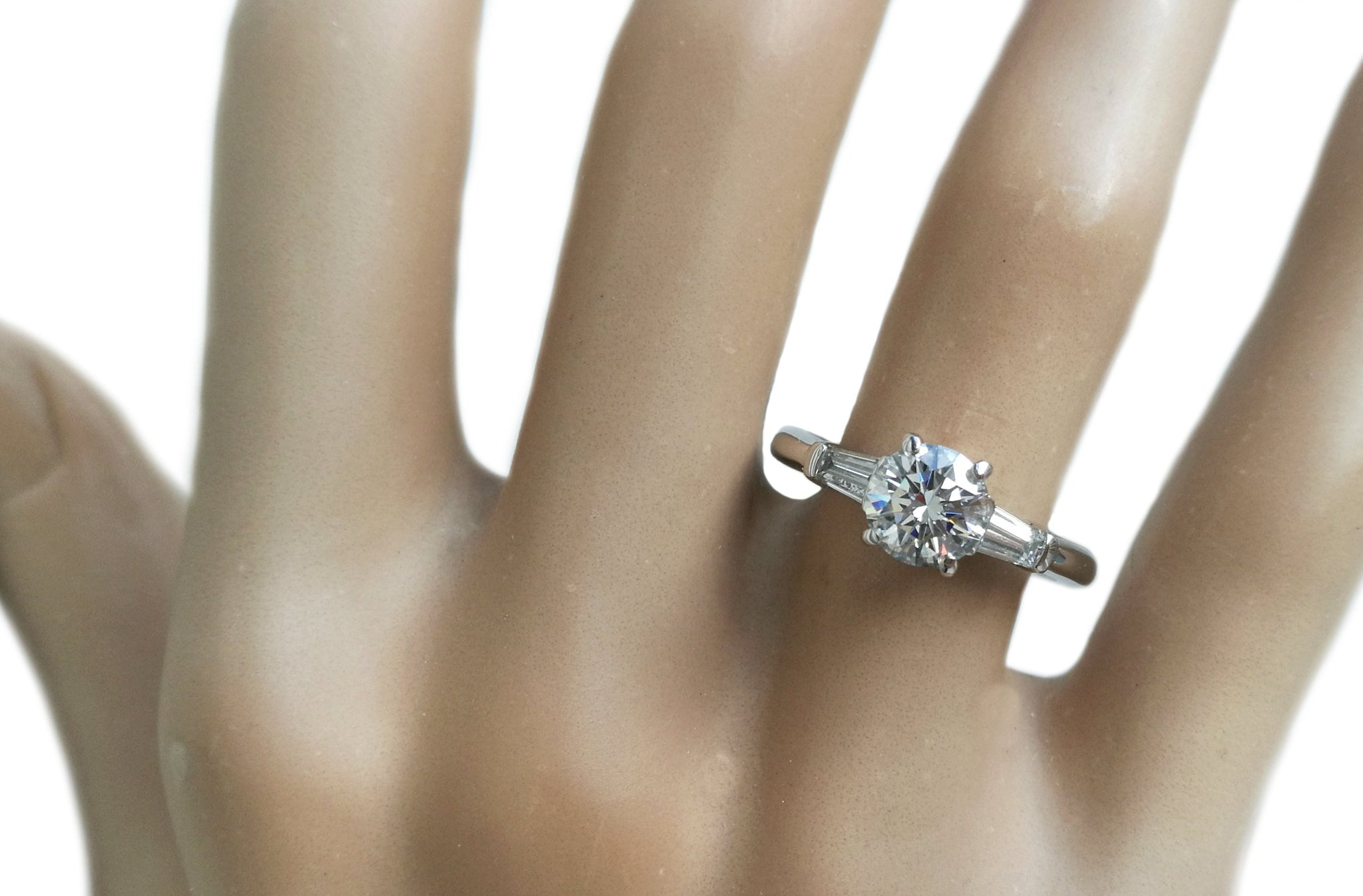 Tiffany & Co. 1.17ct G/VS1 3 Stone Diamond Engagement Ring with Baguette Side Stones on finger