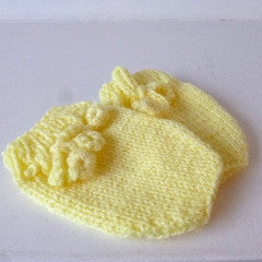 Yellow knitted baby mittens