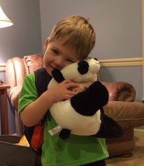Bennet loving on Snuffles Panda!